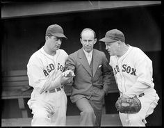 1937 - Moe Berg, Boston Red Sox Rick Ferrell (in civvies), and Boston Red Sox coach Tom Daly in dugout at Fenway Park.