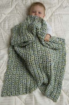 Easy baby blanket - three strands of yarn, single crochet. From Lion Brand.