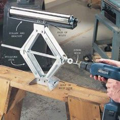 DIY Tip of the Day: Jacked-Up Outfeed Roller. To assemble an adjustable outfeed roller for your table saw and other power tools, drill holes in the base of a scissors jack and bolt it to a sturdy sawhorse. Bolt a bracketed roller (about $20 at woodworking stores) to the top of the jack. For faster adjustments, chuck a screw hook into a cordless drill (photo) and insert it in the jack's drive hole.