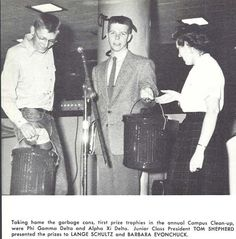 Lange Schultz and Barbara Evonchuck of Phi Gamma Delta and Alpha Xi Delta win prizes for their work during Campus Clean-up in Junior Weekend 1954. From the 1954 Oregana (University of Oregon yearbook). www.CampusAttic.com