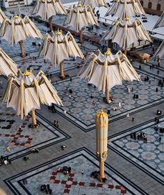 Bodo Rasch's Giant folding Umbrella Canopies at the Medina Mosque, Saudi Arabia - creating the effect of a Translucent Vault when open, as protection from the desert sun.