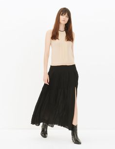 Sandro long two-tone sleeveless dress with round neck. 2-in-1 effect of a top and skirt. Pleats on the subtly transparent top and frayed hem. Slit at the hem of the tone-on-tone printed skirt. Concealed side zip fastening and button forming a teardrop opening at the back.