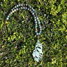 One-of-a-kind Turquoise Leaf Medallion Necklace by Hensley Grace Designs.