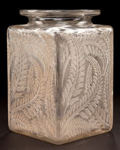 R. LALIQUE CLEAR GLASS MYRRHIS VASE WITH SEPIA PATINA Circa 1926 Stenciled: R. LALIQUE Engraved: France, No 983
