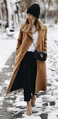 Absolutely must have + camel coat + Karolina + timeless elegance + over a chic white blouse + pair of black denim cut offs + beanie   Coat: House of Mackage.