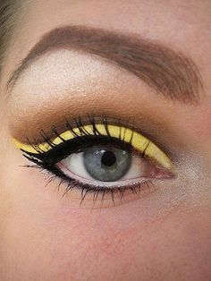 yellow eyeshadow. this pic just reminded me that i have a lovely bright yellow shadow!