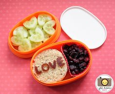 This cute bento was for Kirsten's afternoon nutrition break. She had a circle cut ham and cheese sandwich with some fruit leather LOVE. She also had some craisins in a silicone muffin cup and some cucumbers cut into hearts.    MEET THE DUBIENS