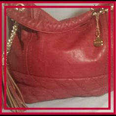 BIG BUDDHA  NWOT PURSE NWOT  BIG BUDDHA RED  VEGAN LEATHER PURSE MAKE A STATEMENT,  LOOK AT YOU!!! ZIPPER POCKET IN THE BACK, FOR CELLPHONE, SMALL CHANGE, LIPSTICK. SMOOTH ON THE TOP, QUILTED ON THE BOTTOM TOSSEL ON THE ONE SIDE, WITH A LOGO PLATE ON THE OTHER. NOT INCLUDED IN BUNDLE DISCOUNT  MUST HAVE IN YOUR CLOSET!!!✔ Big Buddha Bags