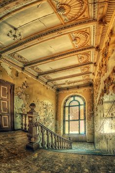 I love staircases that retain their magnificent beauty amid decay.  This abandoned palace in Poland does not disappoint.
