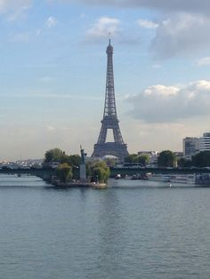 Eiffel Tower & Statue of Liberty in Paris, France along the Seine River.