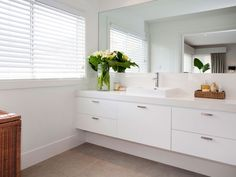 Make your bathroom feel light and bright with white countertops and cabinets! Hamptons House, The Hamptons, Inviting Home, White Countertops, Coastal Homes, White Bathroom, Inspired Homes, White Walls, Powder Room