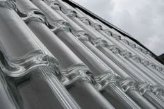 Glass roof tiles that heat your house with solar energy!