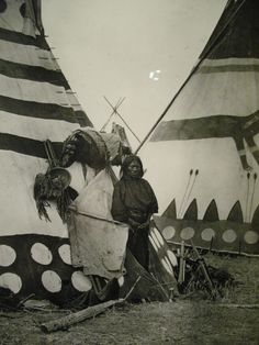 Native American Man in frony of a Tee Pee