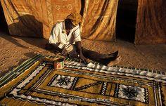 Africa | Bogolan or mud cloth painting, Ende, Dogon Country, Mali | © Ariadne Van Zandbergen