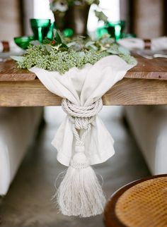 Large tassel at the end of the a table runner. Photo: Ali Harper, Styling: Blue Eyed Yonder. Styled shoot via Snippet & Ink