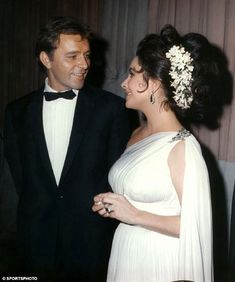 Richard Burton; Born: November 10, 1925 Died: August 5, 1984; & Elizabeth Taylor; Born: February 27, 1932 Died: March 23, 2011