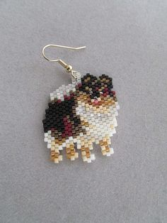 These earrings are sure to be a favorite of the Pomeranian owner or dog lover that you know. They measure about 1-1/4-inches wide and 1-3/8-inches long and are made from approximately 702 tiny seed beads intricately woven, one at a time, with a needle and thread to create the finished earrings you see here.  The pierced fish-hook ear wires are gold-plate over surgical steel. If you prefer to have your little Poms dangle from the post type or clip on type please let me know when you purchase…