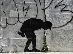´Better out than in´ Street art in London, UK, by Banksy
