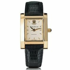 "The Wharton School Women's Swiss Watch - Gold Quad Watch with Leather Strap by M.LaHart & Co.. $299.00. Classic American style by M.LaHart. Swiss-made quartz movement with 7 jewels.. Officially licensed by University of Pennsylvania. Attractive M.LaHart & Co. gift box.. Three-year warranty.. The Wharton School women's gold watch featuring Wharton insignia at 12 o'clock and ""Wharton"" inscribed below on cream dial. Swiss-made quartz movement with 7 jewels. Cream d..."