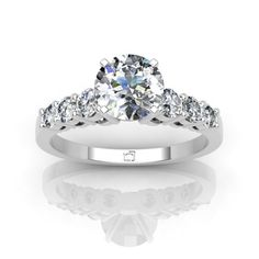 Bling it on with this Graduated Shared Prong Engagment Ring!
