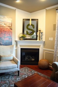 Love this living room fireplace, wall art, & colors from Thrifty Decor Chick.