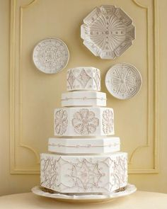 """To play up the geometric designs on Juliska's """"Jardins du Monde"""" and """"Heligan"""" stoneware, which were inspired by the layouts of historic English gardens, Ben-Israel constructed hexagonal tiers of white fondant, then attached pieces of ecru-tinted sugar-paste """"rope"""" with piping gel. Let it set the scene at an outdoor or rustic barn wedding.  """"Jardins du Monde"""" platter as cake stand and round cocktail plates, and """"Heligan"""" dessert plate (all at juliska.com)."""