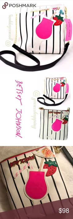 """BETSeY Johnson Daiquiri Crossbody Purse NWT BETSeY Johnson Daiquiri Crossbody Features * A Great Summer Fun Bag! Applique Strawberry Daiquiri with Umbrella and Strawberry Garnish Faux Leather body, Black & White thin striped front; spots on back Gold-tone Hardware. Betsey signature logo in Fuchsia & Gold. Crossbody strap is combo gold chain link and black faux leather Full top zipper closure. Fully lined floral interior Bag MEASURES: 9""""(L) x 8.5"""" (H) x 2""""(D) Crossbody strap has approx 24""""…"""