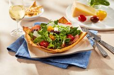 This simple salad kicks it up a notch in a delicious pizza crust serving bowl!