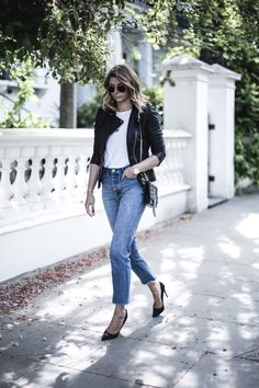 Emma Hill wears black leather biker jacket, basic white t-shirt, frayed hem jeans, YSL black croc tassel bag, Gianvitto Rossi black suede court shoe heels