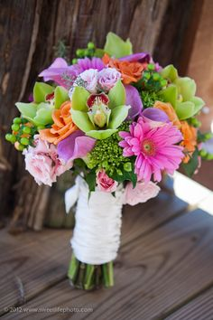The bright green orchids mixed with pink gerberas and lavender lillies made a gorgeous bouquet. Flowers by Flowers on Broad Street.