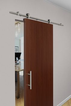 Stainless Steel Sliding Track Hardware System is available with ten styles of door hangers and three finishes to complement any decor.