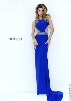 New for 2015...Turn into the nights temptress with the curve-defining column silhouette of Sherri Hill 32140 prom dress. Metallic bands border the bodice, accentuating the yoke and side cutouts while running through the bateau neckline and the natural waist. The slim skirt skims through the thighs before plummeting straight onto the floor with a sweep train. Also available in Black-Gold, Red-Gunmetal and Ivory-Gold.