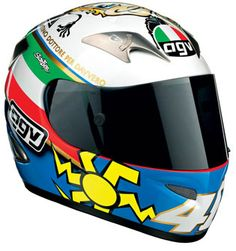 """2005 - This was Rossi's Mugello helmet design for 2005 - the design celebrated Rossi becoming a genuine, real Doctor. Earlier in the same week, Rossi was awarded the """"láurea ad honorem"""" in communications and publicity by his hometown University in Urbino Valentino Rossi Helmet, Motogp Valentino Rossi, Valentino Rossi 46, Agv Helmets, Motorcycle Helmets, Riding Helmets, Helmet Paint, Vr46, Helmet Design"""