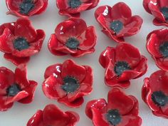 Gorgeous bright red ceramic Poppies! These flowers are hand built from earthenware clay by myself, kiln fired and hand painted with glaze. They
