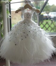 SOLD : 1/12th scale pur white and swarovski crystal dress on hanger.