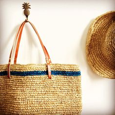Natural Straw Beach Bag with a twist of a nautical navy blue trim.