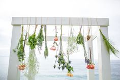 hanging flowers for the ceremony altar