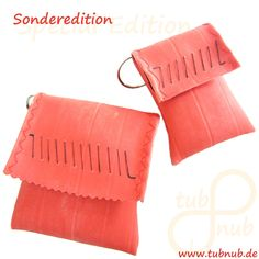 small bags made of red bicycle inner tubes by tubnub