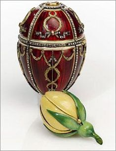 ROSEBUD EGG, 1895.Continuing the tradition established by his father, the Rosebud Egg was the first Faberge egg presented by Tsar Nicholas II to his bride Alexandra.The translucent red-enameled exterior is decorated with Cupid's arrows and contains a miniature portrait of Tsar Nicholas II viewed through a table-cut diamond. Once opened, the egg reveals a yellow enameled rosebud, which blooms to disclose a ruby and diamond-set Imperial crown