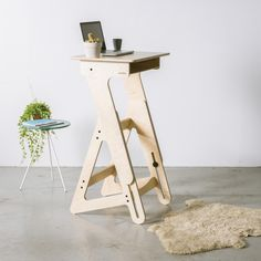Beautifully designed standing desk that is locally produced with high quality wood. This standup desk is perfect for at home or in your office