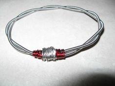 Guitar string bracelet.  I'll make one when I change my sting next time.