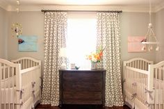 Shared nursery for twins, a boy and a girl - mostly gray and white with just a pop of pink and blue.