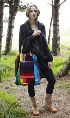 tapestry.  Tote bag made from Mexican blankets cut to display their vibrant patterns and trimmed with vintage leather belts and buckles.