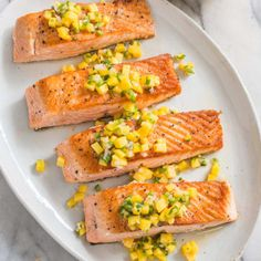 The Key Ingredients to this salmon recipe success is a quick 15 minute soak in brine and keeping the skin on the salmon while frying, the skin will release some fat into the pan so no olive oil is needed to achieve a golden crisp. If desired, you may remove the skin before plating. Serve with lemon wedges or mango salsa and enjoy!