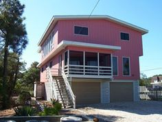 PERFECT IN PINK   Only 3 homes to the ocean, 4 large bedrooms including 2 generous king suites with plush mattresses, the inverted floor plan affords a great room with wonderful living space and an over-sized deck with partial views of the ocean. Central air.  Many amenities. with ample parking. Call for details 1800-732-7433