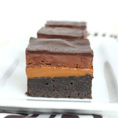 Homemade brownies with 3 layers of caramel and chocolate on top.  These are seriously amazing!