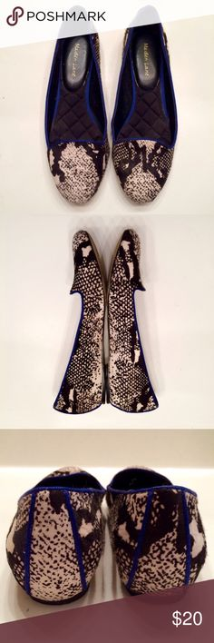 Snake Print Calf Hair Loafers Snake Print Calf Hair Loafers - Black and white snake skin sprinted calf hair upper. Quilted foot pad, cobalt blue ribbon edging. True to size, gently worn. Bottom shows wear but upper and sole in great condition! Maiden Lane Shoes Flats & Loafers