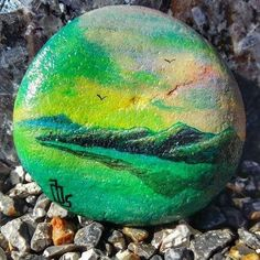Made this stone to a woman with cancer but she past away a week before i finished it now It's on her gravesite. #ranyllbladeart #paintedstones #painting #stones #rock #rocks #art #hobby #creative #paint #acrylic #acrylicpainting #landscape #mountains #sea #sundown