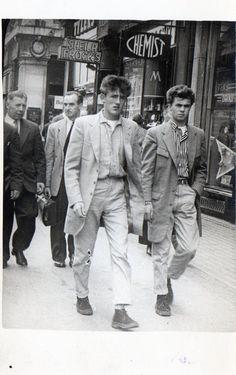 A couple of fashionable Teddy Boys stride along O'Connell Street, Dublin. 1957
