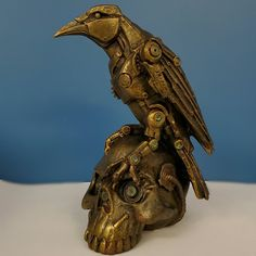 steampunk design, a raven, and a skull! Hand painted bronze with tones of green and pink throughout. Steampunk Bird, Steampunk Design, Steampunk Fashion, Quoth The Raven, Punk Art, Fantasy Artwork, Bird Art, Art And Architecture, Cool Art